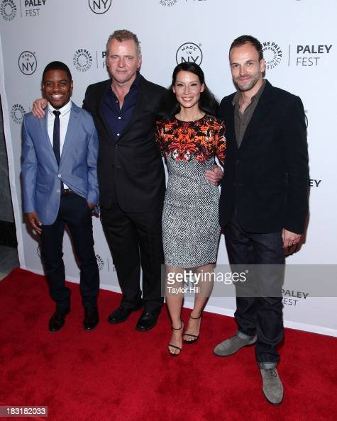 Jon Michael Hill Aidan Quinn Lucy Liu and Jonny Lee Miller attend the 'Elementary' panel during 2013 PaleyFest Made In New York at The Paley Center...