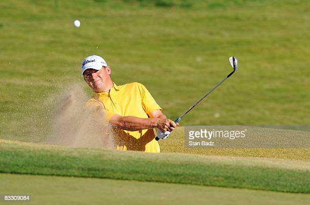 Jon Mills hits out of the bunker at the ninth green during the first round of the Justin Timberlake Shriners Hospitals for Children Open held at TPC...
