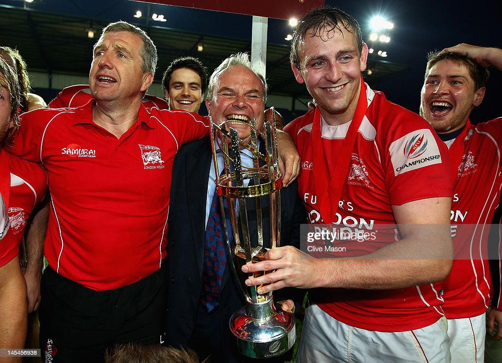 Jon Mills of London Welsh celebrates with the trophy and Bleddyn Phillips Chairman of London Welsh after victory during the RFU Championship Playoff...