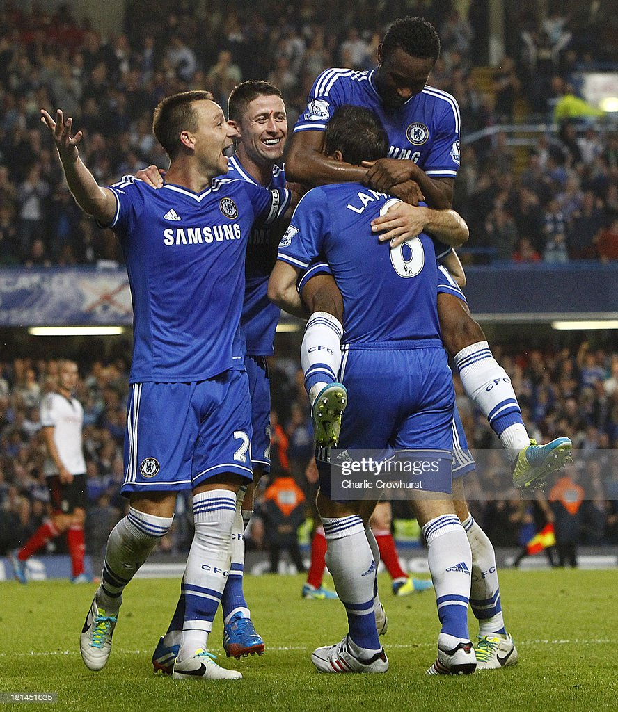 Jon Obi Mikel of Chelsea celebrates with team mates <a gi-track='captionPersonalityLinkClicked' href=/galleries/search?phrase=Frank+Lampard+-+Born+1978&family=editorial&specificpeople=11497645 ng-click='$event.stopPropagation()'>Frank Lampard</a> and <a gi-track='captionPersonalityLinkClicked' href=/galleries/search?phrase=John+Terry&family=editorial&specificpeople=171535 ng-click='$event.stopPropagation()'>John Terry</a> after he scores the teams second goal of the game during the Barclays Premier League match between Chelsea and Fulham at Stamford Bridge on September 21, 2013 in London, England.