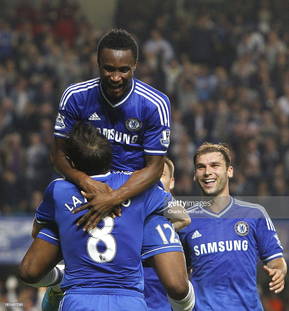 Jon Obi Mikel of Chelsea celebrates with team mates <a gi-track='captionPersonalityLinkClicked' href=/galleries/search?phrase=Frank+Lampard+-+Born+1978&family=editorial&specificpeople=11497645 ng-click='$event.stopPropagation()'>Frank Lampard</a> and <a gi-track='captionPersonalityLinkClicked' href=/galleries/search?phrase=Branislav+Ivanovic&family=editorial&specificpeople=607152 ng-click='$event.stopPropagation()'>Branislav Ivanovic</a> after he scores the teams second goal of the game during the Barclays Premier League match between Chelsea and Fulham at Stamford Bridge on September 21, 2013 in London, England.