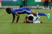Jon Obi Mikel of Chelsea competes for the ball with Joelinton of Rapid Vienna during an friendly match between SK Rapid Vienna and Chelsea FC at...
