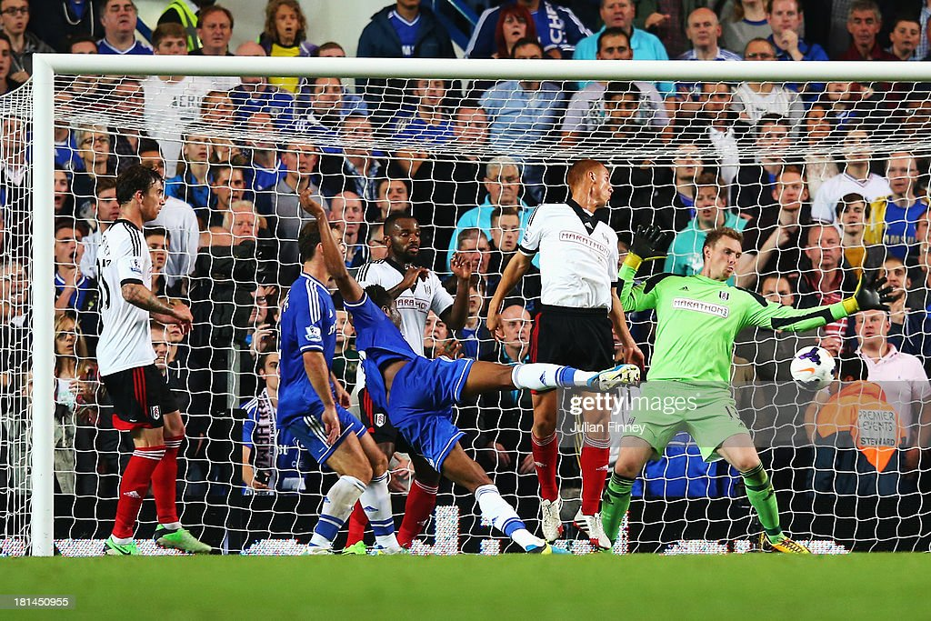 Jon Obi Mikel (C) of Chelsea scores his sides second goal during the Barclays Premier League match between Chelsea and Fulham at Stamford Bridge on September 21, 2013 in London, England.