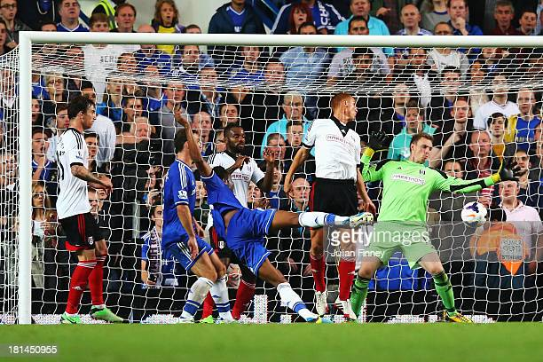 Jon Obi Mikel of Chelsea scores his sides second goal during the Barclays Premier League match between Chelsea and Fulham at Stamford Bridge on...