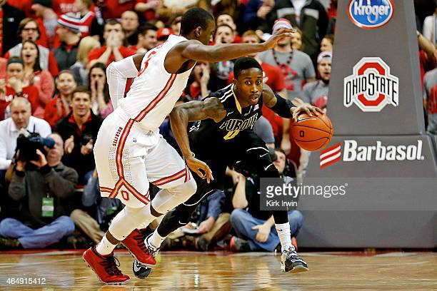 Jon Octeus of the Purdue Boilermakers drives the ball upcourt against the defense of Shannon Scott of the Ohio State Buckeyes during the first half...