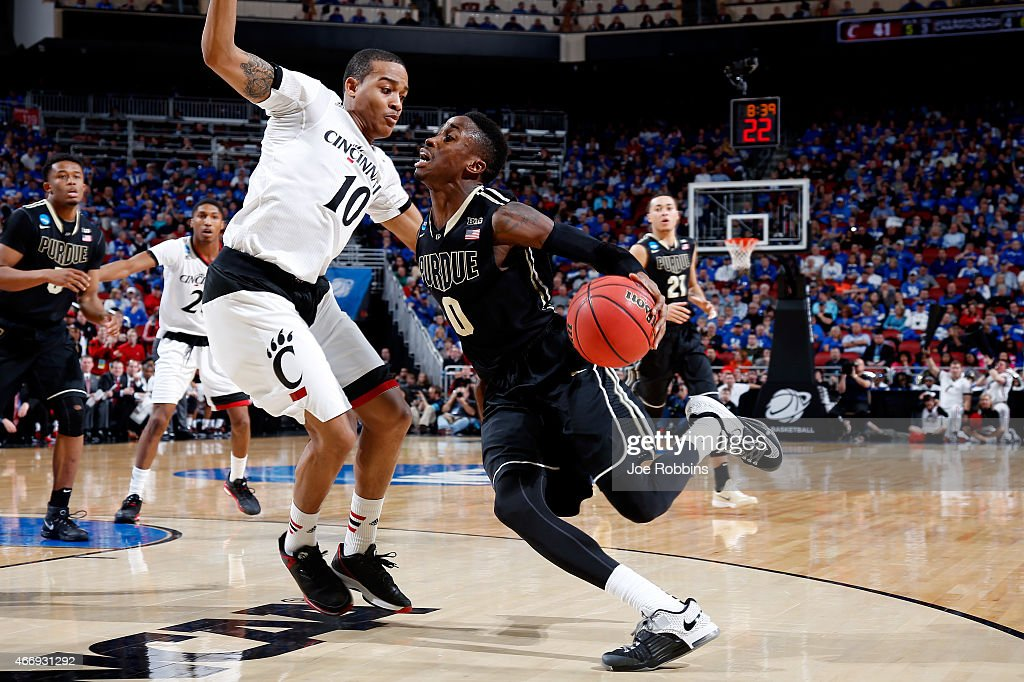 Jon Octeus #0 of the Purdue Boilermakers drives to the basket against Troy Caupain #10 of the Cincinnati Bearcats during the second round of the 2015 NCAA Men's Basketball Tournament at the KFC YUM! Center on March 19, 2015 in Louisville, Kentucky.
