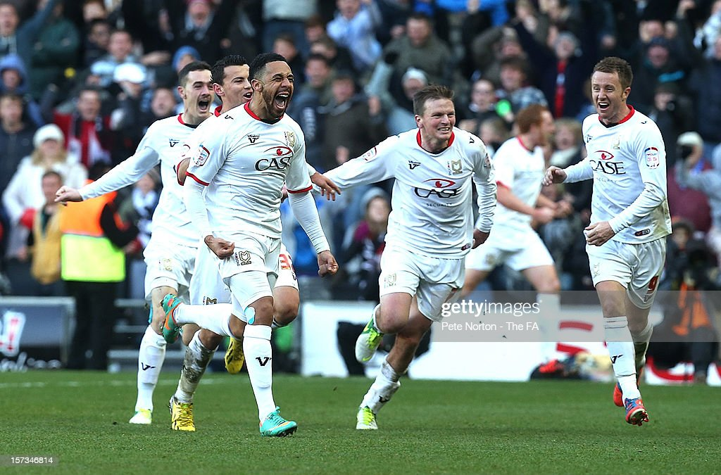 Jon Otsemobor of MK Dons celebrates after scoring his sides 2nd goal during the FA Cup with Budweiser Second Round match between MK Dons and AFC Wimbledon at StadiumMK on December 2, 2012 in Milton Keynes, England.