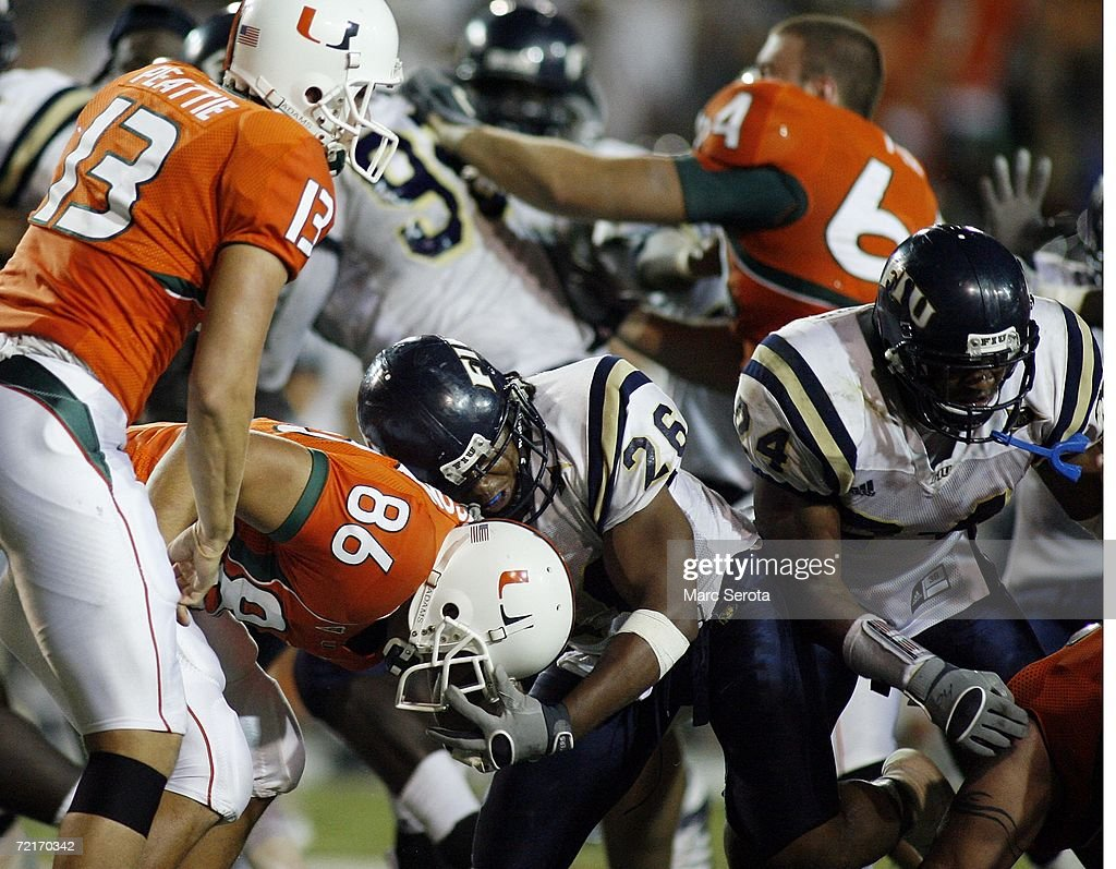 Jon Peattie and Ross Abramson of the University of Miami Hurricanes scuffle with Chris Smith and Marshall McDuffie Jr #24 of the Florida...