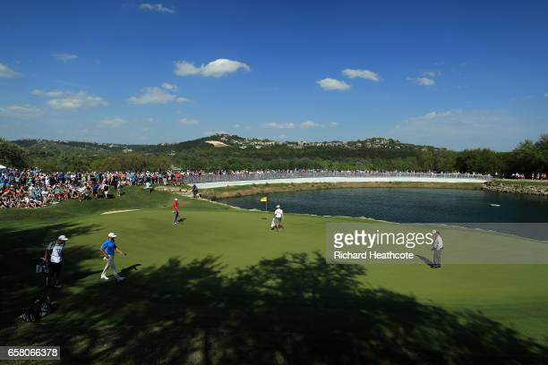 Jon Rahm of Spain and Dustin Johnson walk on the 11th hole during the final match of the World Golf ChampionshipsDell Technologies Match Play at the...