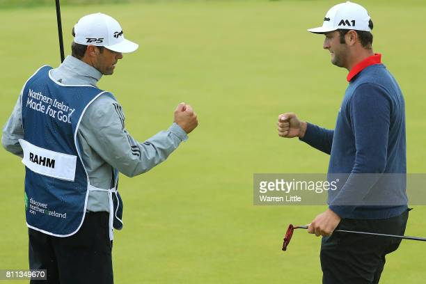Jon Rahm of Spain celebrates an eagle on the 14th hole with his caddie during the final round of the Dubai Duty Free Irish Open at Portstewart Golf...