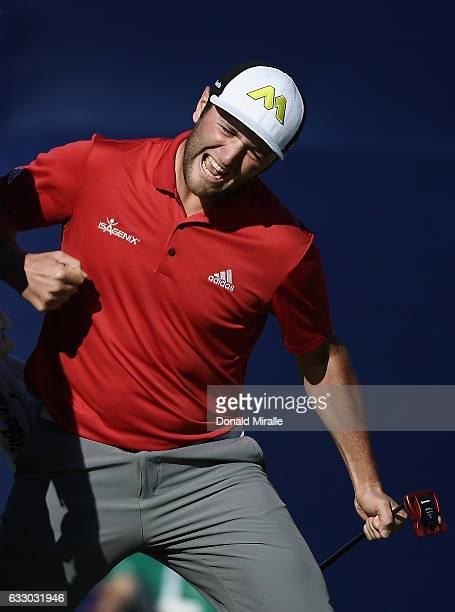Jon Rahm of Spain celebrates his eagle putt on the 18th hole during the final round of the Farmers Insurance Open at Torrey Pines South on January 29...
