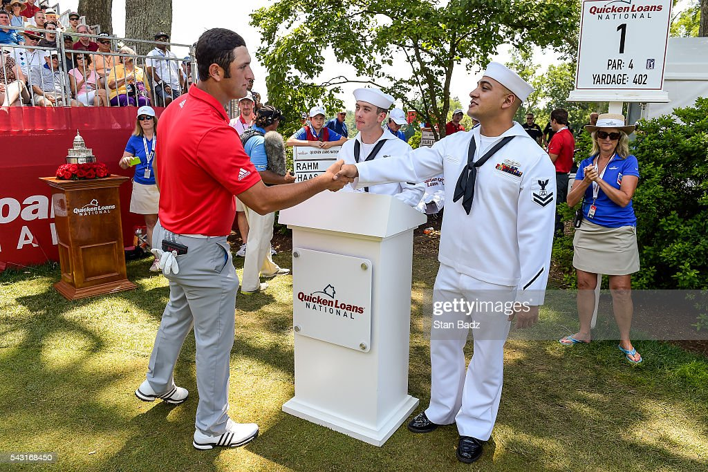 Jon Rahm of Spain greets members of the Armed Forces on the first hole tee box during the final round of the Quicken Loans National at Congressional Country Club (Blue) on June 26, 2016 in Bethesda, Maryland.