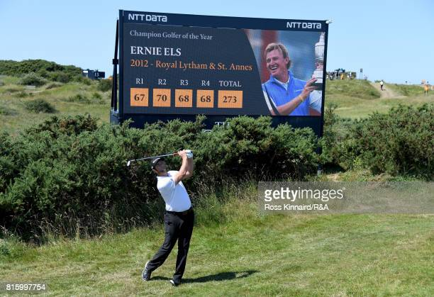 Jon Rahm of Spain hits an approach shot in front of a scoreboard during a practice round prior to the 146th Open Championship at Royal Birkdale on...