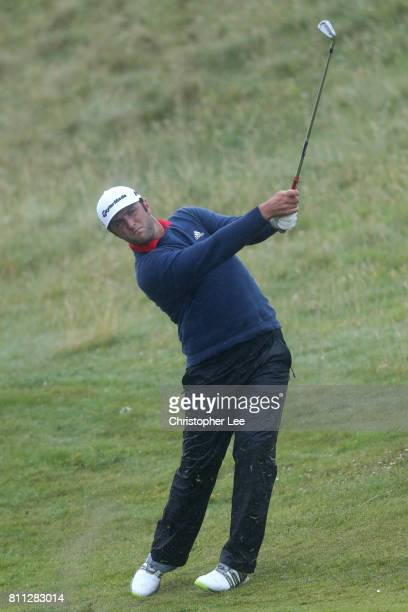 Jon Rahm of Spain hits his third shot on the 4th hole for an eagle during the final round of the Dubai Duty Free Irish Open at Portstewart Golf Club...