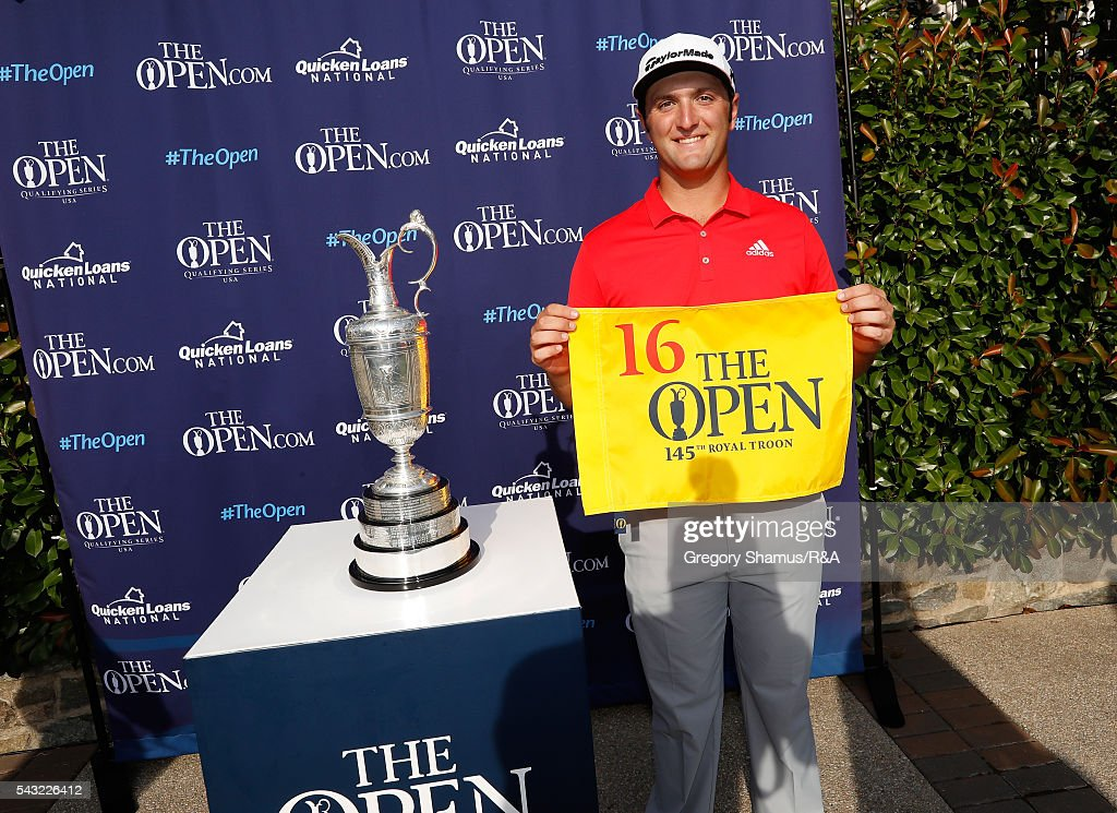 Jon Rahm of Spain holds up a flag after qualifying for the 2016 Open Championship with a tied for third place finish at the Quicken Loans National at Congressional Country Club on June 26, 2016 in Bethesda Maryland.