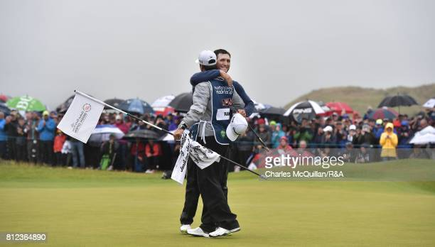 Jon Rahm of Spain hugs his caddy on the 18th green after winning the Dubai Duty Free Irish Open hosted by the Rory Foundation at Portstewart Golf...