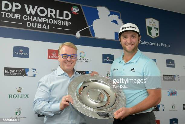 Jon Rahm of Spain is presented with the Rookie of the Year award by European Tour Chief Executive Keith Pelley prior to the DP World Tour...