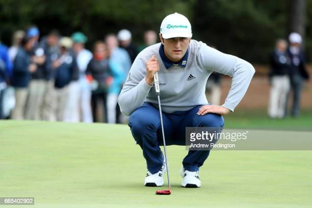 Jon Rahm of Spain lines up a putt on the first green during the first round of the 2017 Masters Tournament at Augusta National Golf Club on April 6...