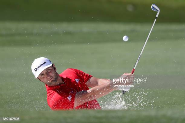 Jon Rahm of Spain plays a shot from a bunker on the 15th hole during the final round of the Wells Fargo Championship at Eagle Point Golf Club on May...