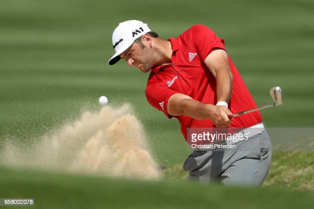 Jon Rahm of Spain plays a shot from a bunker on the 16th hole of his match during the semifinals of the World Golf ChampionshipsDell Technologies...