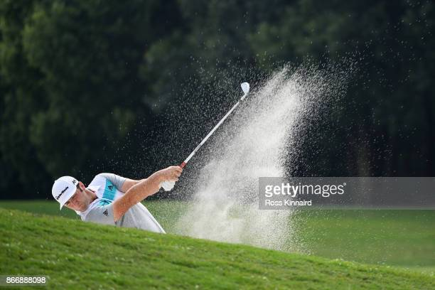Jon Rahm of Spain plays a shot from a bunker on the fifth hole during the second round of the WGC HSBC Champions at Sheshan International Golf Club...