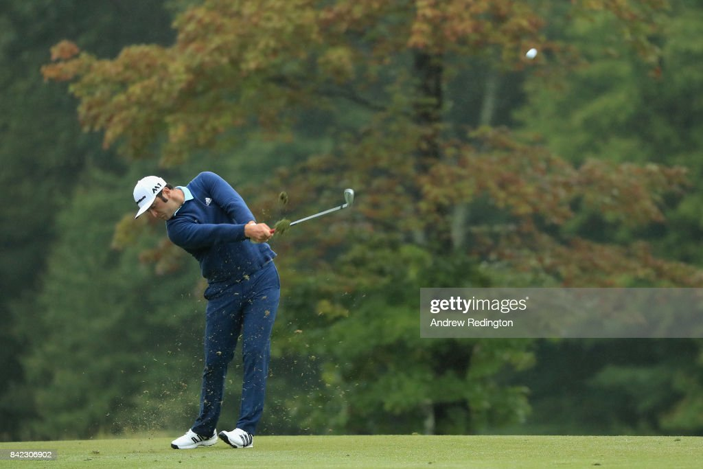 Jon Rahm of Spain plays a shot on the 13th hole during round three of the Dell Technologies Championship at TPC Boston on September 3, 2017 in Norton, Massachusetts.