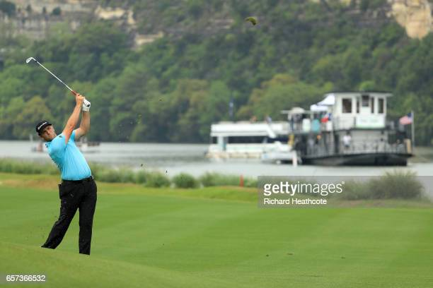 Jon Rahm of Spain plays a shot on the 14th hole of his match during round three of the World Golf ChampionshipsDell Technologies Match Play at the...
