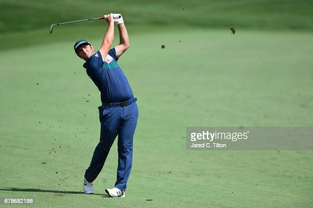 Jon Rahm of Spain plays an approach shot on the 11th hole during round one of the Wells Fargo Championship at Eagle Point Golf Club on May 4 2017 in...