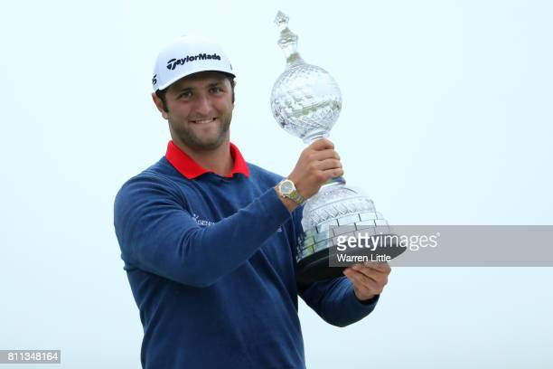 Jon Rahm of Spain poses with the trophy after his victory during the final round of the Dubai Duty Free Irish Open at Portstewart Golf Club on July 9...