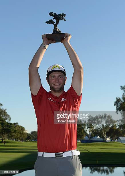 Jon Rahm of Spain poses with the trophy during the final round of the Farmers Insurance Open at Torrey Pines South on January 29 2017 in San Diego...