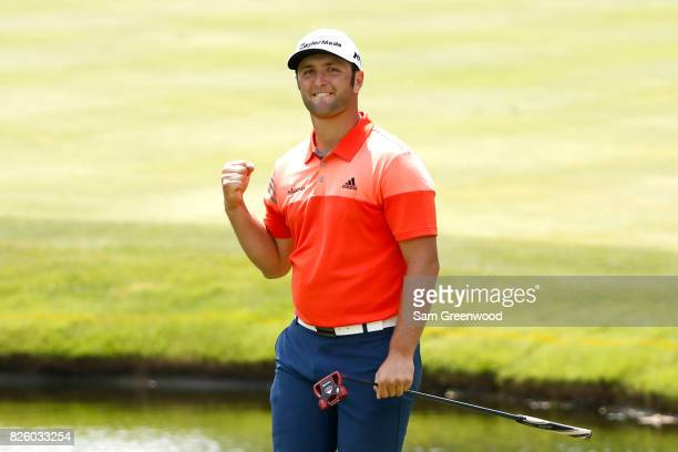 Jon Rahm of Spain reacts after an eagle on the 16th hole during the first round of the World Golf Championships Bridgestone Invitational at Firestone...