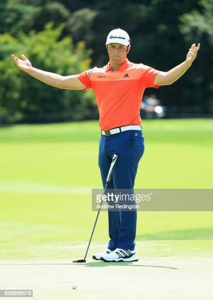 Jon Rahm of Spain reacts after missing a putt on the eighth green during round two of The Northern Trust at Glen Oaks Club on August 25 2017 in...
