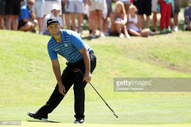 Jon Rahm of Spain reacts after putting on the 9th hole of his match during round five of the World Golf ChampionshipsDell Technologies Match Play at...