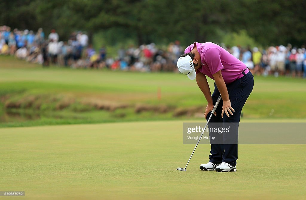Jon Rahm of Spain reacts to his missed eagle putt on the 18th green during the final round of the RBC Canadian Open at Glen Abbey Golf Club on July...