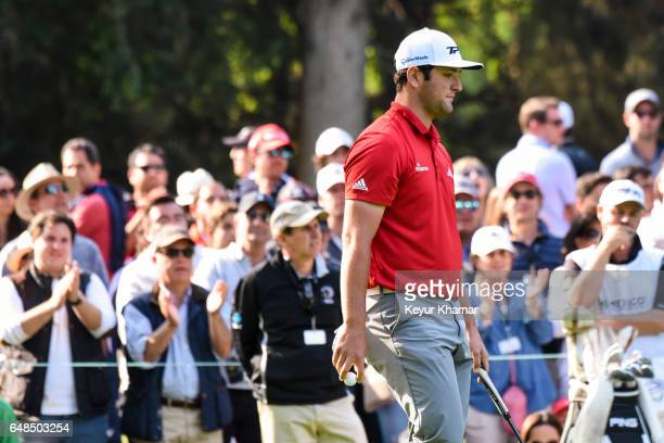 Jon Rahm of Spain reacts to missing a par putt on the 16th hole green during the final round of the World Golf ChampionshipsMexico Championship at...