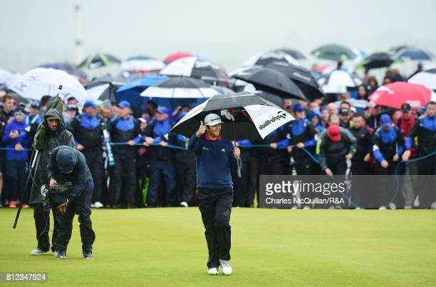 Jon Rahm of Spain reacts to the crowd as he walks towards the 18th green during the final round of the Dubai Duty Free Irish Open hosted by the Rory...
