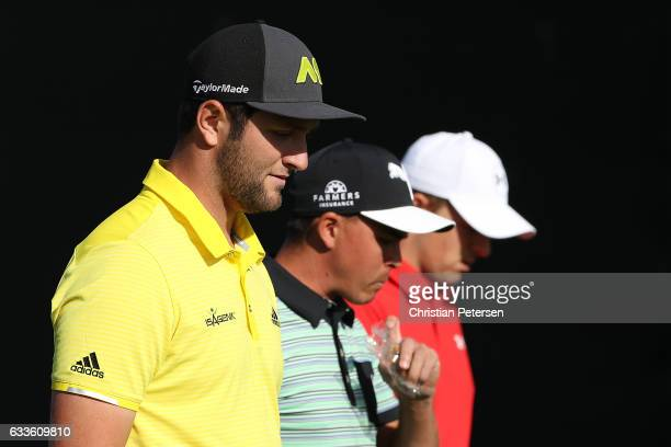 Jon Rahm of Spain Rickie Fowler and Jordan Spieth walk off of the 16th tee box during the first round of the Waste Management Phoenix Open at TPC...