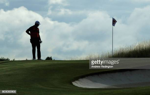 Jon Rahm of Spain stands on the 10th green during day one of the HNA Open de France at Le Golf National on June 29 2017 in Paris France