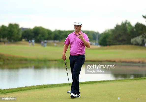Jon Rahm of Spain waves to the crowd on the 18th green during the final round of the RBC Canadian Open at Glen Abbey Golf Club on July 24 2016 in...