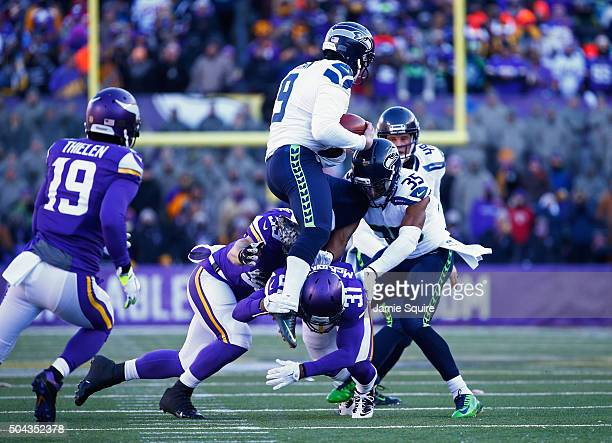 Jon Ryan of the Seattle Seahawks is tackled as he runs with the ball on fourth down in the first quarter against the Minnesota Vikings during the NFC...