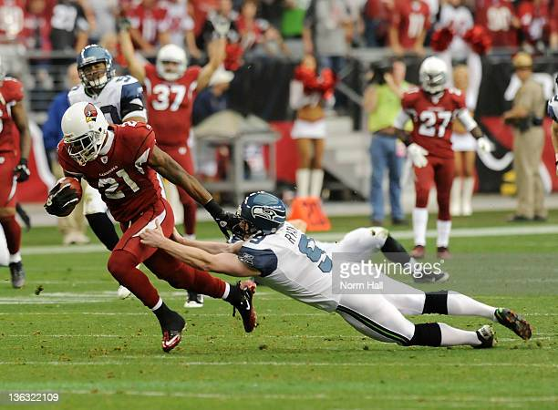 Jon Ryan of the Seattle Seahawks makes a touchdown saving tackle on Patrick Peterson of the Arizona Cardinals at University of Phoenix Stadium on...