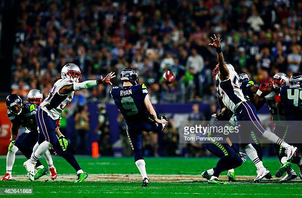Jon Ryan of the Seattle Seahawks punts the ball against the New England Patriots during Super Bowl XLIX at University of Phoenix Stadium on February...