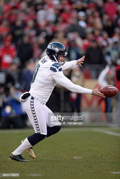 Jon Ryan of the Seattle Seahawks punts the ball against the San Francisco 49ers during the fourth quarter at Candlestick Park on December 8 2013 in...