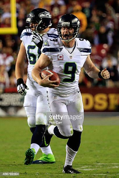 Jon Ryan of the Seattle Seahawks reacts after converting on a fake field goal attempts in the fourth quarter against the Washington Redskins at...