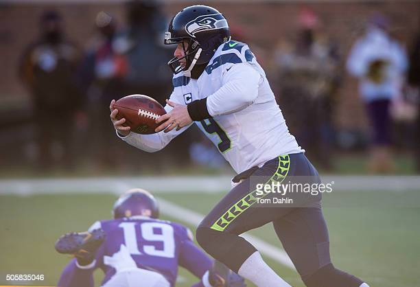 Jon Ryan of the Seattle Seahawks scrambles during an NFL game against the Seattle Seahawks at TCF Bank Stadium January 10 2016 in Minneapolis...
