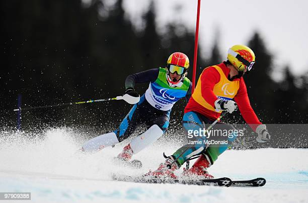 Jon Santacana Maiztegui of Spain and his guide Miguel Galindo Garces compete in the Men's Visually Impaired Super Combined Slalom during Day 9 of the...
