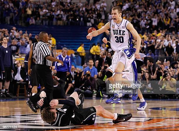 Jon Scheyer of the Duke Blue Devils celebrates after they won 6159 against Matt Howard of the Butler Bulldogs during the 2010 NCAA Division I Men's...