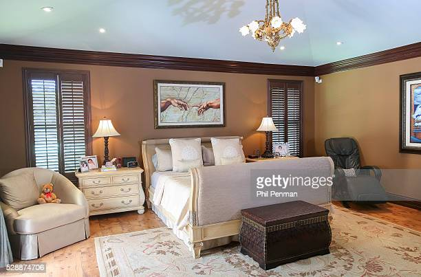 Jon Secada at home in Miami Florida The painting over their bed inspired by Michelangelo's The Creation of Adam was a gift from wife Maritere's...