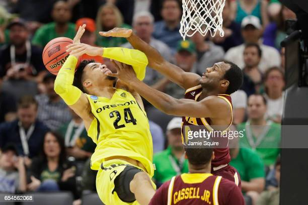Jon Severe of the Iona Gaels fouls Dillon Brooks of the Oregon Ducks in the first half during the first round of the 2017 NCAA Men's Basketball...