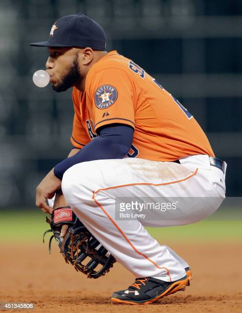 Jon Singleton of the Houston Astros blows a bubble as he awaits the next batter against the Detroit Tigers at Minute Maid Park on June 27 2014 in...